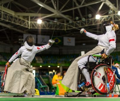 Two wheelchair fencers battle on the piste at the Rio 2016 Paralympics