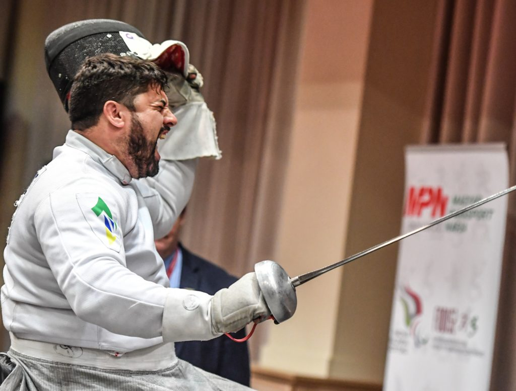 Brazil's Jovane Guissone screams in delight as he rips off his fencing mask