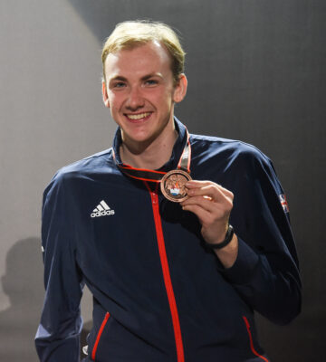 Piers Gilliver poses with a medal