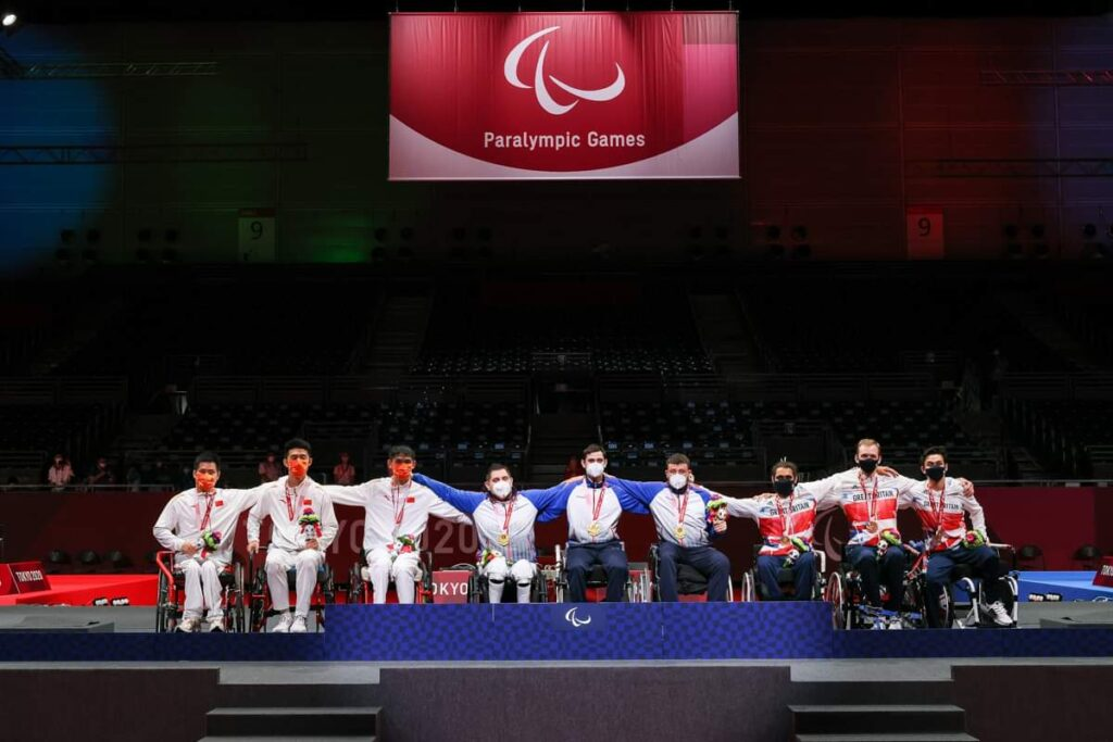 Russia, China and Great Britain pose on the podium of the men's team epee at Tokyo 2020